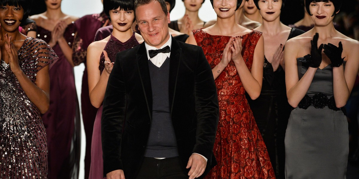 BERLIN , GERMANY - JANUARY 16: Designer Guido Maria Kretschmer acknowledges the audience after the Guido Maria Kretschmer Show during Mercedes-Benz Fashion Week Autumn/Winter 2014/15 at Brandenburg Gate on January 16, 2014 in Berlin, Germany. (Photo by Frazer Harrison/Getty Images for Mercedes-Benz) *** Local Caption *** Guido Maria Kretschmer